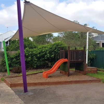 Playground shade sail over play equipment by Shade to Order, Newcastle, Sydney, Central Coast, NSW